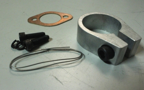 Misc exhaust hardware.  From left to right: safety wire drilled header bolts, exhaust gasket, RLV exhaust clamp